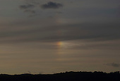 Rainbow cloud at dusk over the River Kent, Arnside, Lancashire, UK.