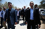 Palestinian Prime Minister Rami Hamdallah attends the funeral of 18-month-old Palestinian baby Ali Dawabsheh, who was killed after his family's house was set on fire in a suspected attack by Jewish extremists in Duma village near the West Bank city of Nablus July 31, 2015. Suspected Jewish attackers torched a Palestinian home in the occupied West Bank on Friday, killing an 18-month-old toddler and seriously injuring three other family members, an act that Israel's prime minister described as terrorism. Photo by Ahmad Talat