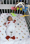 Berkeley CA Baby,(Japanese) two-months-old, fascinated by crib mobile  MR