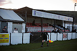 Bacup Borough 4 Holker Old Boys 1, 25/04/2016. Brain Boys West View Stadium, NorthWest Counties League Division One. Spectators standing in front of the main stand watching the first-half action at the Brain Boys West View Stadium as Bacup Borough (in black) play Holker Old Boys in a NorthWest Counties League division one fixture. Formed as Bacup in 1879, the club moved into their current home in 1889 and have been known as Bacup Borough since the 1920s, apart from a brief recent spell when they added the name Rossendale to their name. With both teams challenging for play-off places, Bacup Borough won this fixture by 4-1, watched by a crowd of 50. Photo by Colin McPherson.