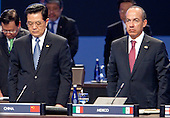 Hu Jintao, China's president, left, and Felipe Calderon, Mexico's president, stand for a moment in silence for recently deceased Polish President Lech Kaczynski during the Nuclear Security Summit at the Washington Convention Center in Washington, D.C., U.S., on Tuesday, April 13, 2010. Ukraine's agreement to relinquish its entire stockpile of highly enriched uranium gave Obama the first concrete result for a summit he convened on securing the world's atomic material..Credit: Andrew Harrer / Pool via CNP