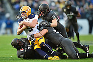 Baltimore, MD - DEC 10, 2016: Navy Midshipmen quarterback Zach Abey (9) is tackled for a loss by a host of Army Black Knights during game between Army and Navy at M&T Bank Stadium, Baltimore, MD. (Photo by Phil Peters/Media Images International)