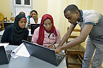Refugee women in a computing class in a school operated by St. Andrew's Refugee Services in Cairo, Egypt. The school is supported by Church World Service.