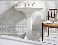 "Sienna 9 5/8"", a hand-cut and waterjet mosaic border, shown in honed Carrara and Thassos, is part of the Miraflores Collection by Paul Schatz for New Ravenna."