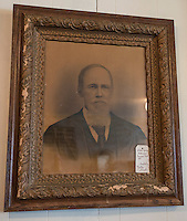 NWA Democrat-Gazette/ANTHONY REYES &bull; @NWATONYR<br /> A picture of one of the founders of Elm Springs, William George Washington Downum, on display Monday, March 21, 2016 inside the Elm Springs Historical Society's 100-year-old building. Exhibits include colonial period, ozark life, costumes and civil war pieces. Across the street from the building is land that will become a park where they have evidence thousands of civil war troops once camped.