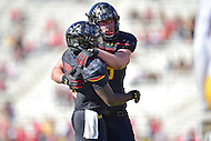 College Park, MD - OCT 15, 2016: Maryland Terrapins quarterback Tyrrell Pigrome (3) celebrates a touchdown with teammate during game between Maryland and Minnesota at Capital One Field at Maryland Stadium in College Park, MD. (Photo by Phil Peters/Media Images International)