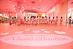 Staff dressed in Hello Kitty clothing welcome guests to the opening of Hello Kitty's Kawaii (Cute) Paradise, a Hello Kitty theme store, in Tokyo, Japan on Thursday 21 October  2010. .Photographer: Robert Gilhooly