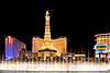 Bellagio Fountains at Night with the Paris Eiffel Tower in the Background, Las Vegas, Nevada