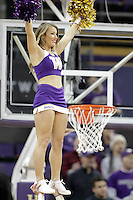 DEC 22, 2015:  Washington cheerleader Nikki Buchanan entertained fans during a TV timeout in the game against Seattle University. Washington defeated Seattle University 79-68 at Alaska Airlines Arena in Seattle, WA.