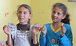 Girls participate in a group activity at the Youth Empowerment Center in Beit Hanoun, Gaza. The program is supported by Caritas and DanChurchAid, a member of the ACT Alliance, and is designed to help children better cope with the trauma they experienced during the 2014 war.<br /> <br /> In the wake of that war between the government of Gaza and the government of Israel, ACT Alliance members are supporting health care, vocational training, rehabilitation of housing and water systems, psycho-social care, and other humanitarian actions throughout the besieged Palestinian territory.