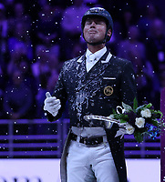 OMAHA, NEBRASKA - APR 1: Carl Hester is doused in champagne during the FEI World Cup Dressage Final awards ceremony at the CenturyLink Center on April 1, 2017 in Omaha, Nebraska. (Photo by Taylor Pence/Eclipse Sportswire/Getty Images)