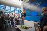 "Visitors watch a yoga demonstration at the Experience Intel: Look Inside pop-up ""shop"" in the Meatpacking District in New York on Friday, May 17, 2013. The promotional event, which is part of a world tour, aims to expose consumers to various brands of computers, mostly touch screen pc's running Windows  8, all running on Intel chips. Because of tablets, smartphones and other mobile gadgets there has been a drop in sales in laptops and other personal computers. (© Richard B. Levine)"