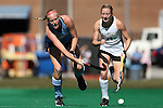 25 October 2014: North Carolina's Nina Notman (GER) (left) and Wake Forest's Sarah Thornhill (14). The University of North Carolina Tar Heels hosted the Wake Forest University Demon Deacons at Francis E. Henry Stadium in Chapel Hill, North Carolina in a 2014 NCAA Division I Field Hockey match. UNC won the game 3-1.