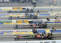 Apr. 15, 2012; Concord, NC, USA: NHRA top fuel dragster drivers (from top) Shawn Langdon, Tony Schumacher, Doug Kalitta and Terry McMillen race during the Four Wide Nationals at zMax Dragway. Mandatory Credit: Mark J. Rebilas-