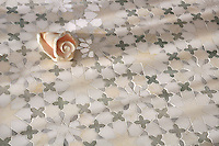 Granada, a natural stone waterjet mosaic shown in Heavenly Cream honed, Ming Green, Carrara, Thassos polished marbles is part of the Miraflores Collection by Paul Schatz for New Ravenna Mosaics.