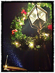 """Christmas wreath and snow falling in Market Square, Portsmouth, New Hampshire. iPhone photo - suitable for print reproduction up to 8"""" x 12""""."""