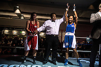 England.London. 19th September 2014.<br /> The referee holds up Harvinder Jutte's hand as she is announced the winner of her fight against Emily Williams at a white collar boxing event at the London Irish Centre where the 'Carpe Diem' boxing event is taking place. <br /> <br /> 'White-collar boxing' is a growing phenomenon amongst well paid office workers and professionals and has seen particular growth in financial centres like London, Hong Kong and Shanghai. It started at a blue-collar gym in Brooklyn in 1988 with a bout between an attorney and an academic and has since spread all over the world. The sport is not regulated by any professional body in the United Kingdom and is therefore potentially dangerous, as was proven by the death of a 32-year-old white-collar boxer at an event in Nottingham in June 2014. The London Irish Centre, amongst other venues, hosts a regular bout called 'Carpe Diem'. At most bouts participants fight to win. Once boxers have completed a few bouts they can participate in 'title fights' where they compete for a replica 'belt'.  <br /> <br /> <br /> <br /> <br /> <br /> &copy;Andrew Testa for the Sunday Times Magazine