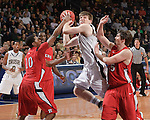 Forward Jack Cooley (45) goes up for a shot between Rutgers Scarlet Knights guard Mike Poole (10) and forward Gilvydas Biruta (55).