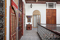 First floor central courtyard area with windows and doors to bedrooms and living quarters off the balustraded balcony, in a typical Tetouan riad, a traditional muslim house built around a courtyard, built in Moorish style with strong Andalusian influences, next to the Great Mosque or Jamaa el Kebir in the Medina or old town of Tetouan, on the slopes of Jbel Dersa in the Rif mountains of Northern Morocco. Tetouan was of particular importance in the Islamic period from the 8th century, when it served as the main point of contact between Morocco and Andalusia. After the Reconquest, the town was rebuilt by Andalusian refugees who had been expelled by the Spanish. The medina of Tetouan dates to the 16th century and was declared a UNESCO World Heritage Site in 1997. Picture by Manuel Cohen