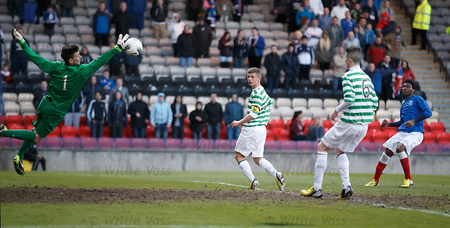 Junior Ogen curls in his second goal of the game and the third for Rangers past Celtic keeper Jordan Hart