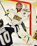 12 February 2011: University of Vermont Catamount goaltender Roxanne Douville, a Freshman from Beloeil, Quebec, makes a save against the University of New Hampshire Wildcats at Gutterson Fieldhouse in Burlington, Vermont. The Lady Wildcats shut out the Lady Cats 2-0 to split their Hockey East twin game weekend series. Mandatory Credit: Ed Wolfstein Photo
