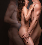 Erotic fantasy photo of a naked couple. Nude woman and a man with a ghost of a second man behind her.