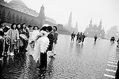 Moscow, Russia<br /> October 19, 1992<br /> <br /> A wedding in Red Square.<br /> <br /> In December 1991, food shortages in central Russia had prompted food rationing in the Moscow area for the first time since World War II. Amid steady collapse, Soviet President Gorbachev and his government continued to oppose rapid market reforms like Yavlinsky's &quot;500 Days&quot; program. To break Gorbachev's opposition, Yeltsin decided to disband the USSR in accordance with the Treaty of the Union of 1922 and thereby remove Gorbachev and the Soviet government from power. The step was also enthusiastically supported by the governments of Ukraine and Belarus, which were parties of the Treaty of 1922 along with Russia.<br /> <br /> On December 21, 1991, representatives of all member republics except Georgia signed the Alma-Ata Protocol, in which they confirmed the dissolution of the Union. That same day, all former-Soviet republics agreed to join the CIS, with the exception of the three Baltic States.