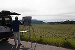 Artist painting the vineyards of Chateau Grand Traverse Vineyards and Winery, Old Mission Peninsula, Lake Michigan, Traverse City area, Michigan, USA