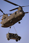 Italian Ch 47 Chinook carrying a Lince jeep in Afghanistan