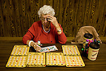 TIME, Arapahoe County Assignment..Small towns in far eastern Arapahoe County.  Byers, Deer Trail, Aurora, Watkins...Western towns, urban.  Littleton, Aurora....Betty Englebrecht plays multiple Bingo cards at the weekly game held at the American Legion hall in Byers, Colorado.  The hall sees between 20 and 70 residents each week from surrounding communities for the game.