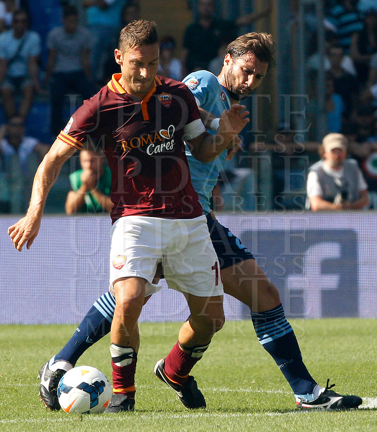 Calcio, Serie A: Roma vs Lazio. Roma, stadio Olimpico, 22 settembre 2013.<br /> AS Roma forward Francesco Totti, left, is challenged by Lazio defender Lorik Cana, of Kosovo, during the Italian Serie A football match between AS Roma and Lazio, at Rome's Olympic stadium, 22 September 2013.<br /> UPDATE IMAGES PRESS/Riccardo De Luca