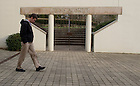 January 15, 2012; Colin Campbell walks past a gate on the main walkway to the retreat house and church at Gethsemani. The University of Notre Dame Folk Choir held a concert for the Monastic and local community during their 2012 retreat at The Abbey of Gethsemani, Trappist, Kentucky. Photo by Barbara Johnston/University of Notre Dame