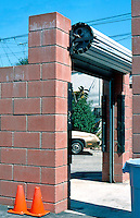 Eric Owen Moss: Roll-up Entrance at east end of enclosed Gary Group Parking Lot, behind Laundry Bldg. Photo 1999.