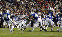 BYU's Braden Brown punts the ball in the fourth quarter as Brigham Young University plays against Utah at LaVell Edwards Stadium in Provo, Utah, Saturday, Nov. 28, 2009. August Miller, Deseret News .
