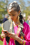 May 5, 2013 - Hempstead, New York, U.S. - An Indian female dancer, using her cell phone, will soon be sharing the rich heritage of India in dance, at the 30th Annual Dutch Festival celebrating Hofsta University's Global Campus. The performers wear traditional makeup, gold jewelry, and colorful silk costumes.