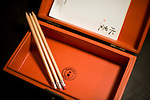 A lacquerware box containing writing paper and pencils is displayed on a side table at Suiboku Lofts in Hirafu village in the Niseko ski region of Hokkaido, Japan on Feb. 5 2010.