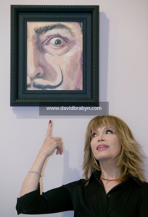 22 April 2006 - New York City, NY - French actress, singer and television personality Amanda Lear poses in front of her artwork on display in a gallery in New York City, USA, 22 April 2006.