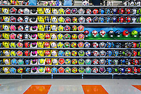A large selection of soccer balls of various brands on display in the new Dick's Sporting Goods store in Valley Stream, Long Island, New York during its grand opening sales on Saturday, July 9, 2016. Dick's recently purchased the intellectual property of its bankrupt competitor Sports Authority with a $15 million bid pending the courts' final approval on July 15.   (© Richard B. Levine)