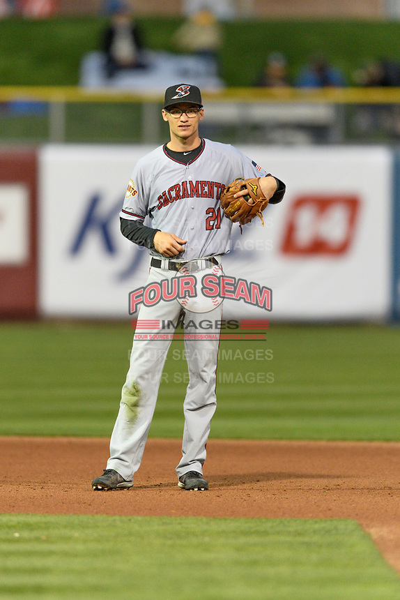 Kelby Tomlinson (21) of the Sacramento River Cats on defense against the Salt Lake Bees in Pacific Coast League action at Smith's Ballpark on April 11, 2017 in Salt Lake City, Utah. The River Cats defeated the Bees 8-7. (Stephen Smith/Four Seam Images)