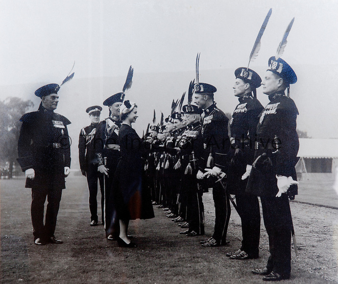 Queen Elizabeth II inspecting the Royal Company of Archers, the Sovereigns's bodyguard in Scotland. Her captain-General (behind her) bearing his gold stick of office is the 13th Earl of Stair