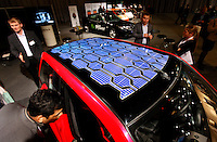 "Cars with alternative fuel options, including electrical car,solar power, and bio fuel. Rava car in front, with solar panel on roof. Renewable sources will be helping to meet the world's demand for energy in the future. This development opens new markets and opportunities for business. Hoping to make ""green business"" and ""green profit"" over 60 exhibitors took part in the The North European Renewable Energy Convention (Nerec) , in Norway, presenting their solutions for renewable energy in the future. .© Fredrik Naumann/Felix Features"