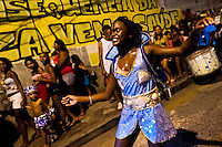 A Brazilian dancer performs during the Carnival parade in the favela of Rocinha, Rio de Janeiro, Brazil, 20 February 2012. Rocinha, the largest shanty town in Brazil and one of the most developed in Latin America, has its own samba school called GRES Academicos da Rocinha. The Rocinha samba school is very loyal to its neighborhood. Throughout the year, the entire community actively participate in rehearsals, culture events and parades related to the carnival.