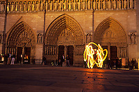 Playing with fire in front of Notre-Dame de Paris, 2011