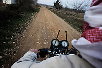 SYRIA - Al Qsair. Driving on dirt roads around Al Qseyr to avoid Syrian Army on January 23, 2012. Al Qsair is a small town of 40000 inhabitants, located 25Km south-west of Homs. The town is besieged since the beginning of November and so far it counts 65 dead. ALESSIO ROMENZI