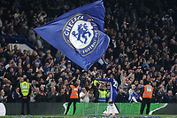 Chelsea's Willian celebrates at the final whistle by waving a very large flag during Chelsea vs Watford, Premier League Football at Stamford Bridge on 15th May 2017