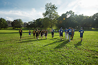 Players from the Mt. Airy Stars and the Potter Pirates walk across the field at New Covenant Church to clear the field of debris before the demontration of the vintage baseball game.