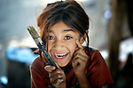 """THIS PHOTO IS AVAILABLE AS A PRINT OR FOR PERSONAL USE. CLICK ON """"ADD TO CART"""" TO SEE PRICING OPTIONS.   A Roma girl in Suto Orizari, Macedonia. The mostly Roma community, located just outside Skopje, is Europe's largest Roma settlement. ."""