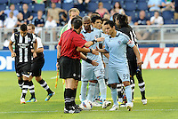 Sporting KC players Omar Bravo (99) and Julio Cesar (55) players shake hands with the officals and Newcastle United players prior to the game... Sporting Kansas City and Newcastle United played to a 0-0 tie in an international friendly at LIVESTRONG Sporting Park, Kansas City, Kansas.