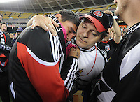 DC United forward Jaime Moreno (99) with founder of Barra Brava Oscar Zambrano at the end of the game.  Toronto FC. defeated DC United 3-2 at RFK Stadium, October 23, 2010.