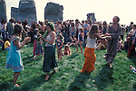 1970's style hippies attend the second free festival at Stonehenge to celebrate the summer solstice June 21st 1975.